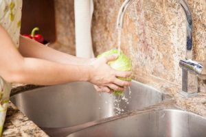 washing-lettuce-in-kitchen-sink