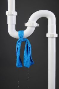 white-pipe-with-blue-cloth-tied-on-it
