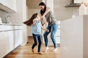woman-and-child-dancing-on-wood-floor